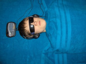 Man Using Light Sound Machine for Best Brain Functiong